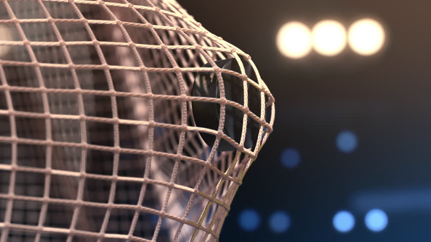 Hockey puck flies into the net. Close-up (4k, 3840x2160, ultra high definition)