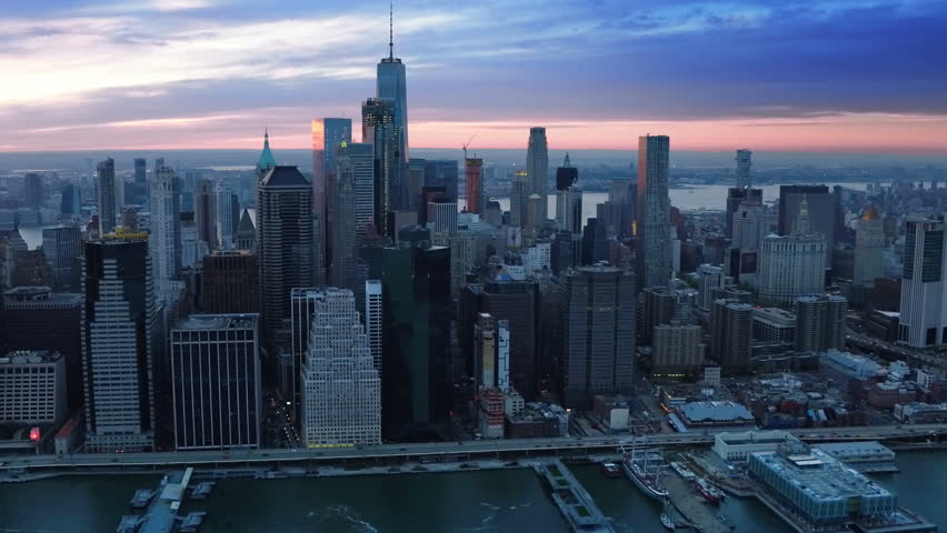 Aerial view above the East River. Famous Manhattan skyscrapers. Traffic passing by. Manhattan. Sunset. United States, North America. Shot from a helicopter. | Shutterstock HD Video #30979834