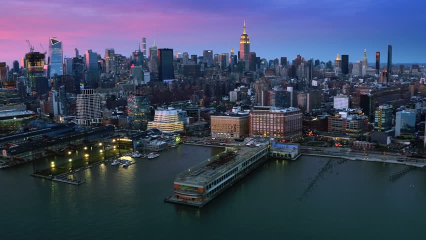 Aerial view above the Hudson River. Famous Manhattan skyscrapers. Traffic passing by West Avenue. Manhattan. United States, North America. Shot from a helicopter. | Shutterstock HD Video #30979855
