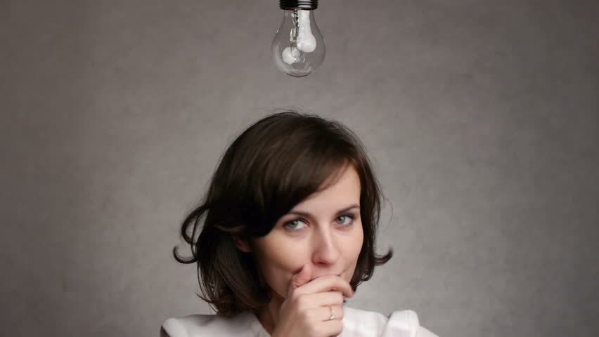 pensive woman gets an idea, which lights up a symbolic lamp over her head #3099574
