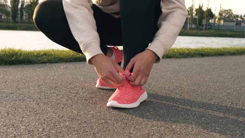 Human hand tying sports shoes | Shutterstock HD Video #31004308