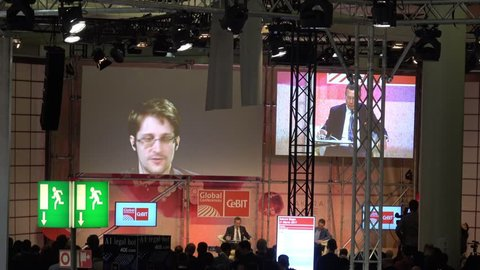 Hannover, Germany - March, 2017: Edward Snowden live video conference on exhibition fair Cebit 2017 in Hannover Messe, Germany
