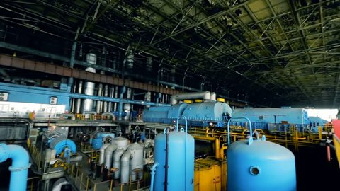 VINNITSA, UKRAINE - JULY 2017: Steam turbine and shaped pipes at power plant