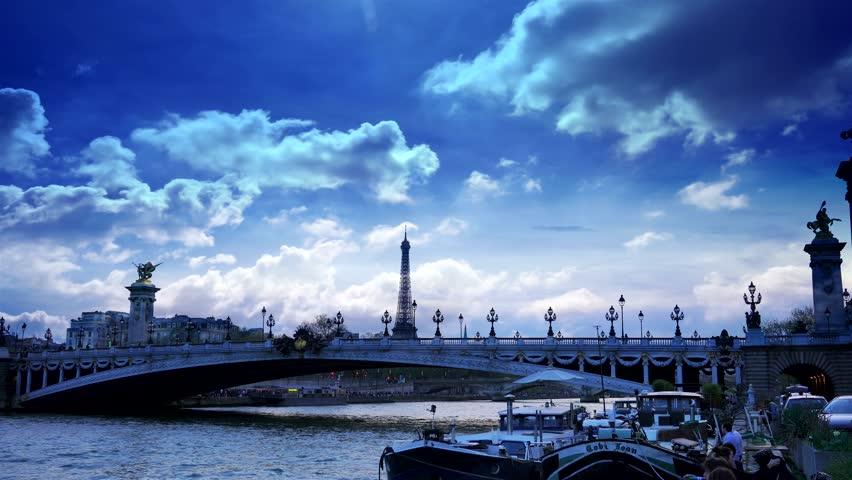 PARIS, FRANCE - 11 Sep, 2017:Traditional parisian buildings and Famous Alexander The Third bridge, tourist boat along Seine river in Paris, France. | Shutterstock HD Video #31028662