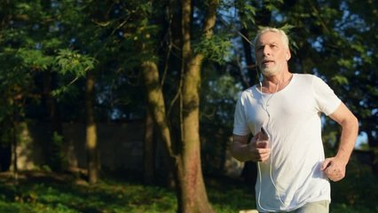Confident senior man jogging in the park
