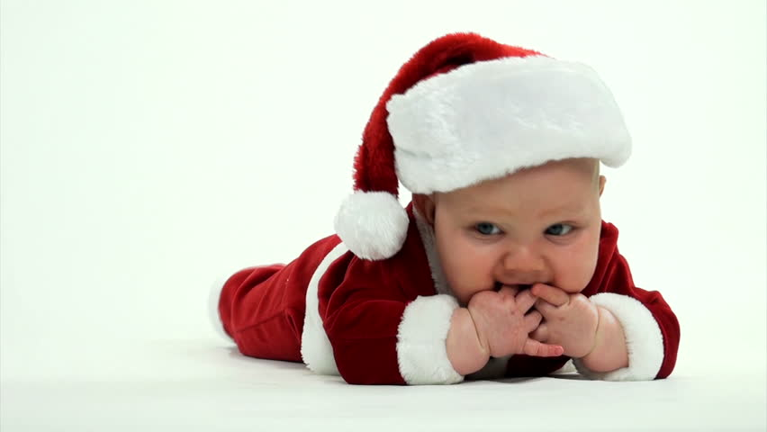 7a3b581b3 Cute 7-month-old baby boy in red Santa Claus outfit on white background