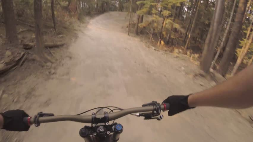 Spectacular 4k first person pov of man riding fast extreme sport mountain bike performing dangerous stunt on forest road | Shutterstock HD Video #31037869