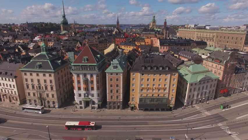 Flying over city buildings in Stockholm, Sweden. Aerial drone view of Stockholm Old Town. Shot in 4K UHD