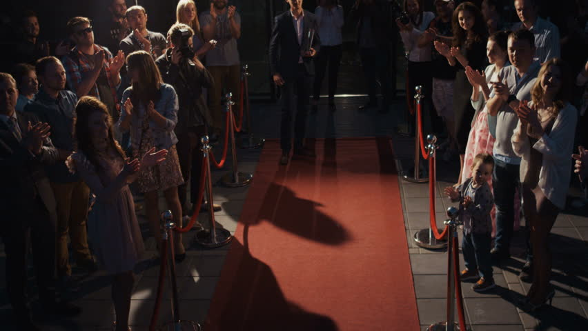 Back-sided scene, famous people award concept, young smart bearded man clothes walking across red oscar carpet, people waiting award ceremony famous actor, trophy prize hype fame famous star reward   Shutterstock HD Video #31044766