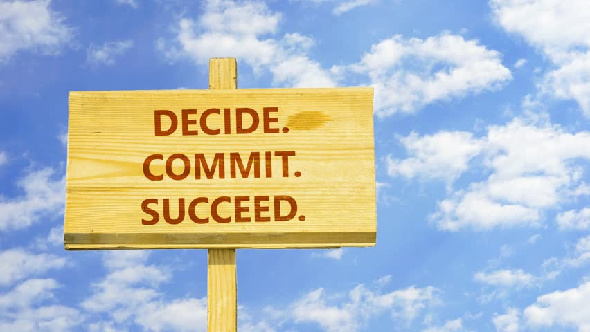 Decide, commit, succeed. Words on a wooden sign against time lapse clouds in the blue sky.