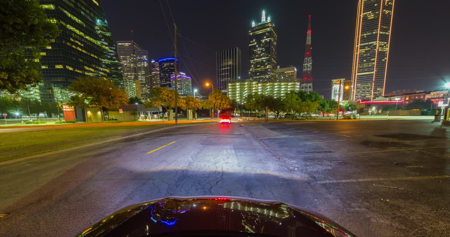 Vehicle Driving at Night in Downtown Dallas Time-lapse. a time-lapse view of the front of a vehicle traveling through downtown Dallas texas at night