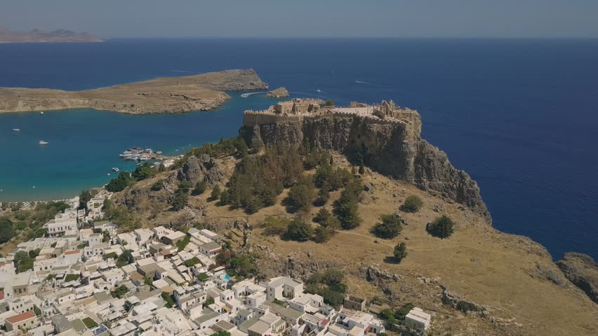 Aerial view of ancient Acropolis and village of Lindos, Rhodes, Greece | Shutterstock HD Video #31134634