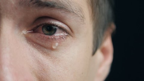Shot of Crying man with tears in eye closeup