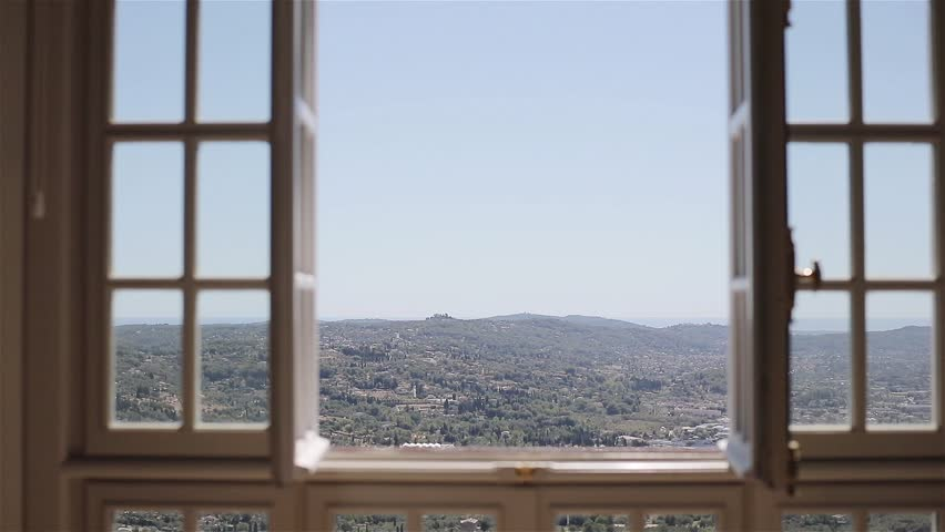 Panoramic view of Italian or French valley town from open window. Green hills landscape and roofs of French Riviera Grasse in Europe from villa on top of mountain. Fresh countryside air in sky concept | Shutterstock HD Video #31193944