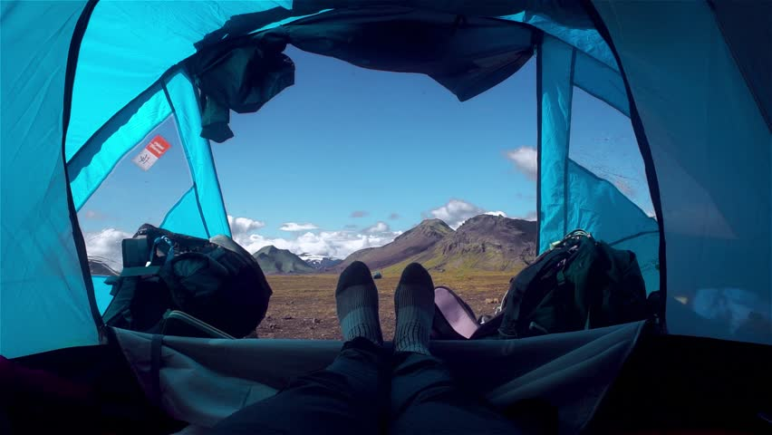 Man in tent with a view of mountains #31282474
