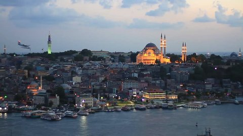 Eventide in Istanbul. View from Galata Tower to Old Istanbul. Looking over Golden Horn to Suleymaniye Mosque, in distance famous landmarks such as Beyazit Tower and Eminonu motor port.