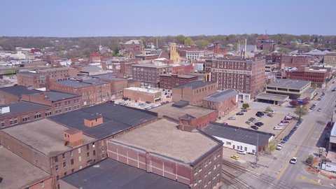 CIRCA 2010s - Burlington, Iowa - Rising aerial shot over small town America Burlington Iowa downtown.