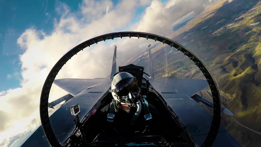 CIRCA 2010s - View of the interior cockpit of a fighter pilot flying.