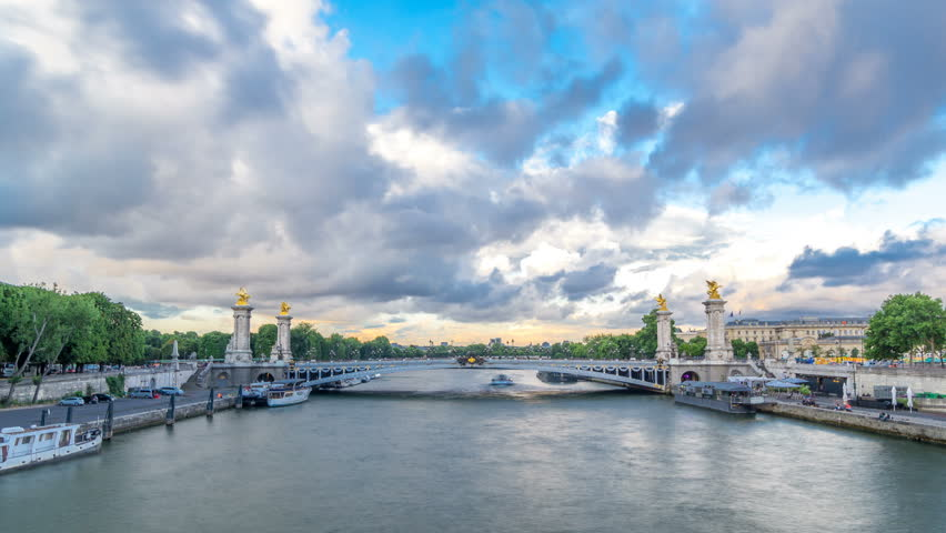Bridge of Alexandre III spanning the river Seine timelapse hyperlapse. Decorated with ornate Art Nouveau lamps and sculptures. View from Invalides bridge. Paris. France. Blue cloudy sky before sunset | Shutterstock HD Video #31390408