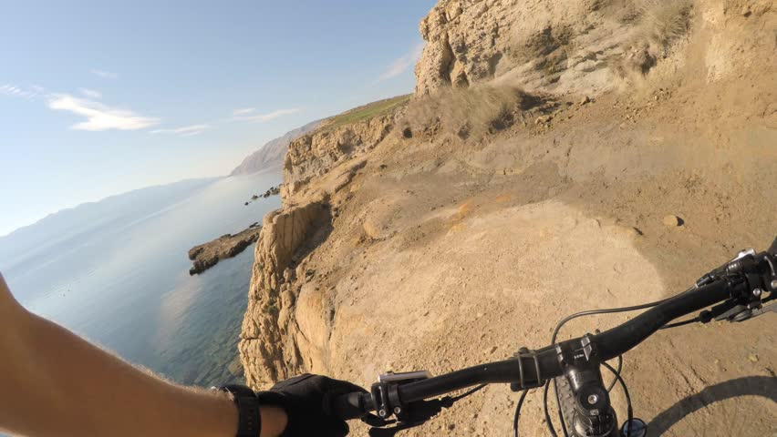 Man riding enduro mountain bike on rocky trail. View from first person perspective POV. Gimbal stabilized video. Shot with GOPRO HERO4 4K.