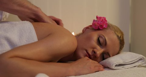 Beautiful Young Blonde Woman Relaxing with Massage Treatment Health Beauty Spa
