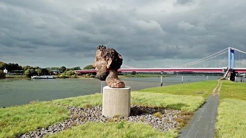 DUISBURG / GERMANY - OCTOBER 03 2017 : The sculpture Echo of the Poseidon created by Markus Lueppertz is greeting all mariners on the mercator island