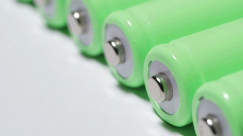 Rechargeable lithium-ion batteries are rolling. Conservation and accumulation of green electricity. Ecological concept. close-up, smooth movement.
