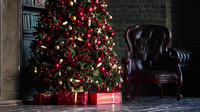classic christmas background with new year tree presents under flashing garland and chair - Classic Christmas Trees