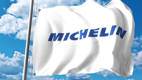 Waving flag with Michelin logo against clouds and sky. 4K editorial animation