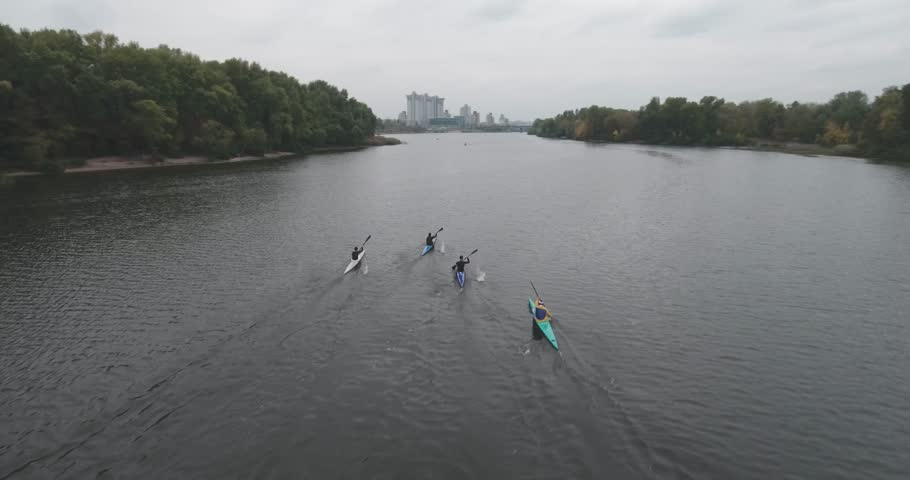 Aerial survey. kayaking competitions in Kiev on September 30, 2017. athletes started a long distance in the river Dnipro. 5 km you need to rake up a straight line. camera kayaking.  | Shutterstock HD Video #31525354