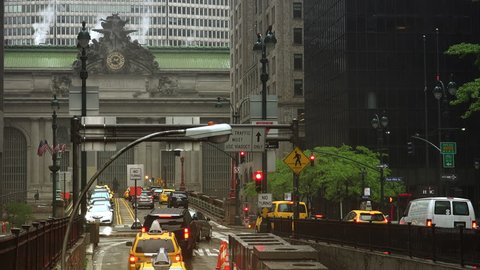 NEW YORK CITY - circa 2017: vehicle traffic flowing from Park Avenue Tunnel toward Grand Central Terminal in a rainy day, ultra hd 4k