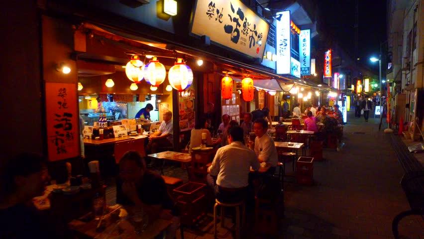 Tokyo, Japan - September 11, 2017 :tracking shot of Ueno izakaya bar alley. Side of the street are lined with izakaya bars.