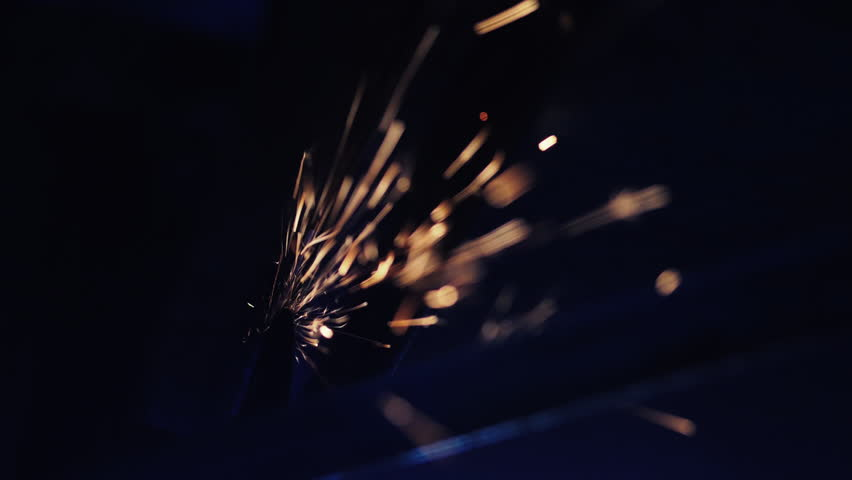 Flies of spark from hot metal. Worker grinding metal construction with a circular saw. Slow Motion. | Shutterstock HD Video #31565884