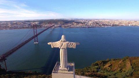Christ the King (Cristo Rei) statue in Almada, Lisbon, Portugal, aerial view.