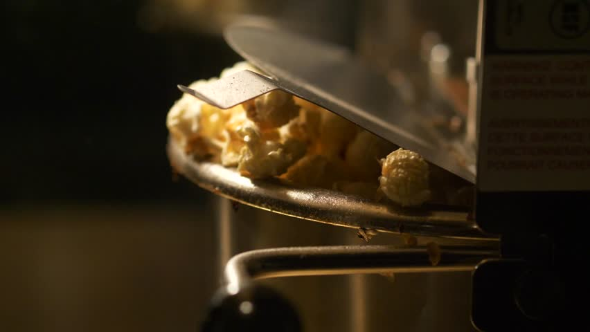 Fresh roasted pop corn pop out of the bowl - pop corn maker in a movie theater | Shutterstock HD Video #31587964
