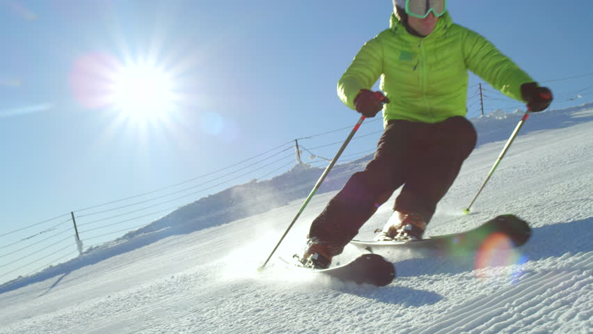 SLOW MOTION CLOSE UP: Young adult recreational skier enjoys idyllic perfect weather in cold winter. Skiing alone on perfectly groomed ski piste at ski resort. Located at the top of the mountain | Shutterstock HD Video #31600189