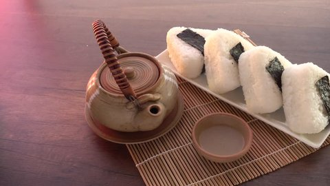 Onigiri, Japanese food, Japanese rice ball, rice triangle with nori seaweed and Japanese rice or  Uruchimai  rice