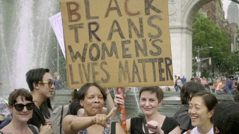 NEW YORK JUNE 24, 2017: Black Trans Women Lives Matter Transgender Rights Sign Washington Square Park NYC. A demonstration for LGBT rights filled the public park on the hot summer day.