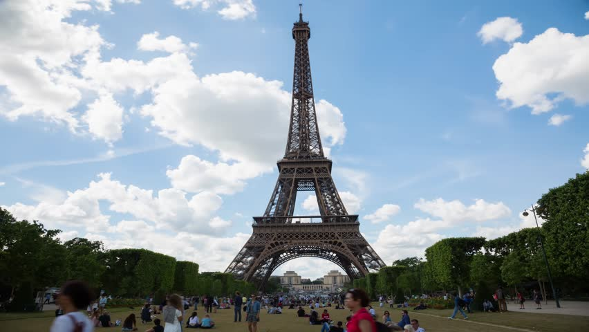 PARIS, FRANCE - JUNE 05, 2017: Eiffel Tower timelapse from the Champ de Mars by a sunny evening. | Shutterstock HD Video #31638436