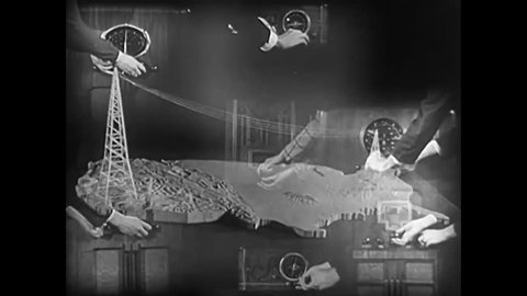 CIRCA 1937 - Strange circus footage with elephants wearing Chevy advertisements, superimposed hands turning radio knobs and a violin orchestra with men in black attire.