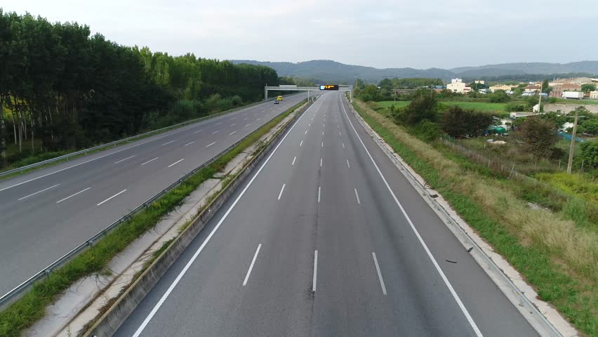 Aerial with European Highway Traffic Jam in One Direction Empty free Lanes in the other Direction   Shutterstock HD Video #31661503