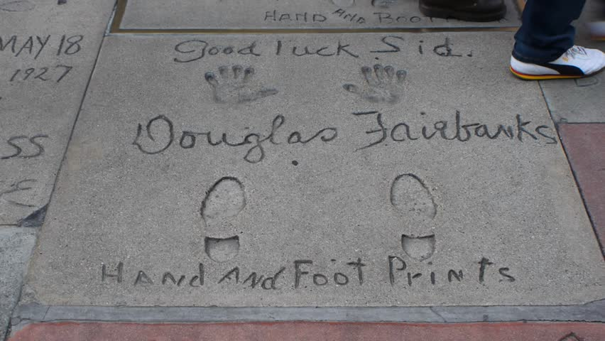 HOLLYWOOD, LOS ANGELES - CIRCA 2011: Movie Stars' foot and hand prints in the forecourt of Grauman's Chinese Theatre on Hollywood Boulevard in Los Angeles.