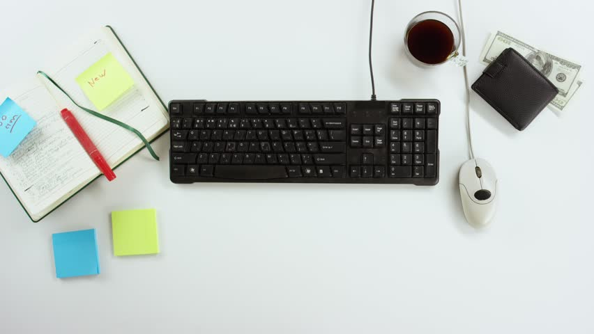 Top down view of man working on computer with cup of coffee on desk | Shutterstock HD Video #31678795