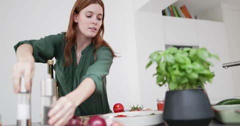 Adult female seasoning a dish