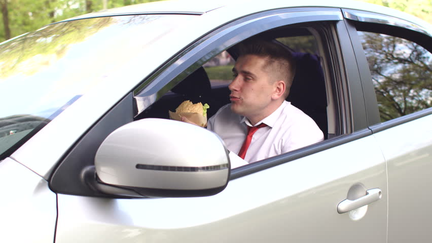 Businessman Eating Fast Food While Stock Footage Video (100% Royalty-free)  31708834 | Shutterstock