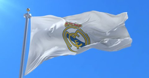 Real Madrid Football Club Flag waving in slow motion with blue sky, looped