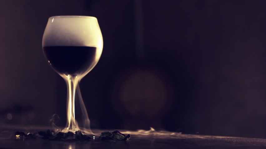 Red wine in glass with dry ice | Shutterstock HD Video #31720264