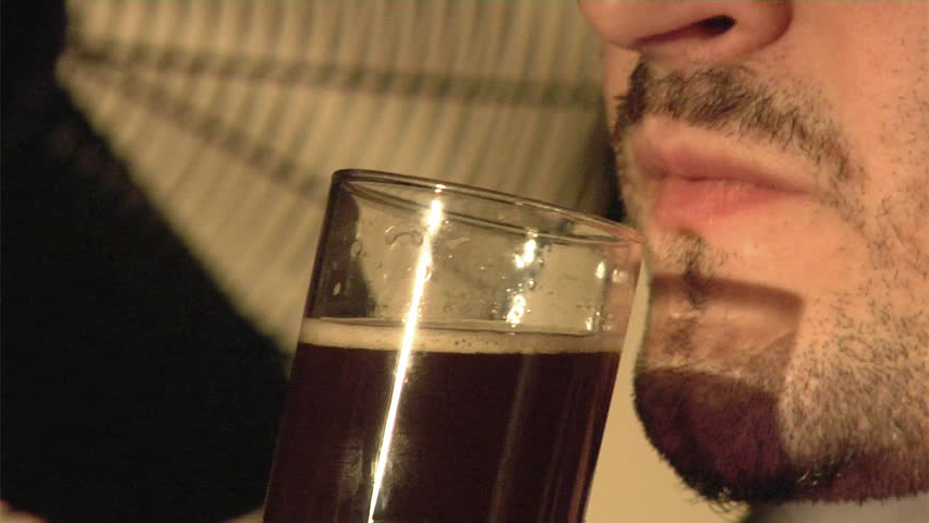 man drink dark beer