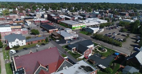 A day slow forward aerial establishing shot of the small town of Salem, Ohio's business district.