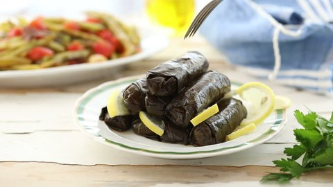 Dolma dish on a table served by the chef